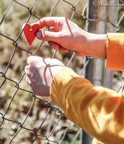hanging-heart-on-fence